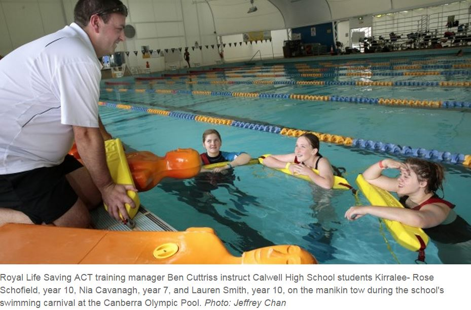 Students using lifesaving equipment on Aquatics Day